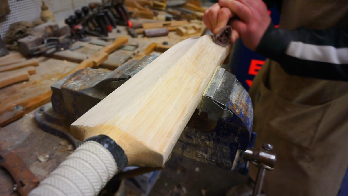 Hand sanding the back of the cricket bat